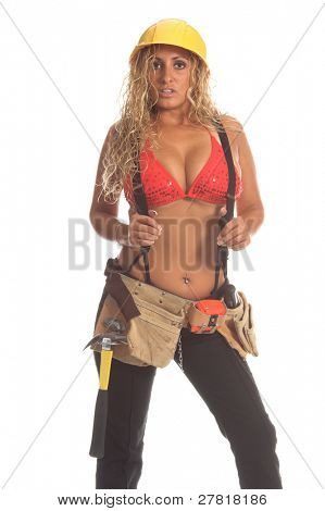 Sexy Latina construction worker in black jeans, suspenders a bikini top, tool belt and hard hat.