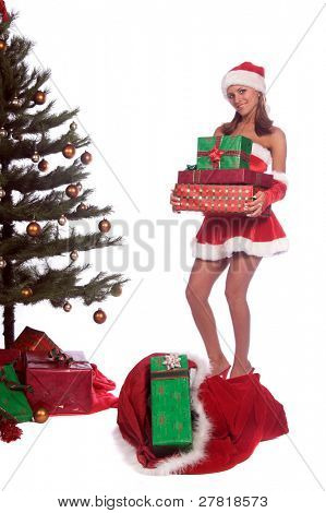 Santa's sexy blond helper unloading Christmas Gifts from Santa's bag and placing them under the tree