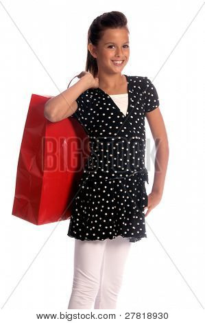 Twelve, 12 year old girl with a big red shopping bag, a huge smile and the shopping strut of a seasoned professional