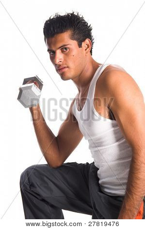 Young Hispanic man doing arm curls with free weights