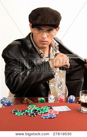 Upset gambler pulls a gun while playing Texas Hold um Poker in a game gone bad.