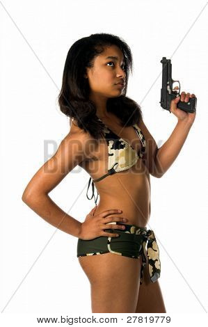 Beautiful young African American woman in a camo bikini poised and ready with a 45 caliber handgun in her left hand