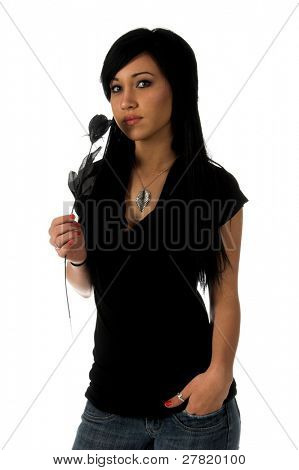 Teenage girl with jet black hair and green eyes, dressed in black and holding a black rose