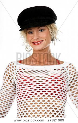 Sexy OC blonde fashion model in a denim skirt, net top and red bra and a sporty black hat. isolated over white.