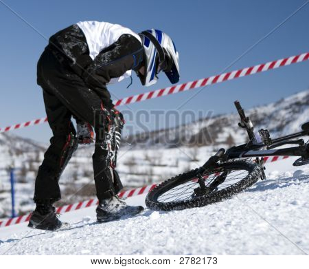 Snow Biker Downhill In Winter Mountains Tien Shan