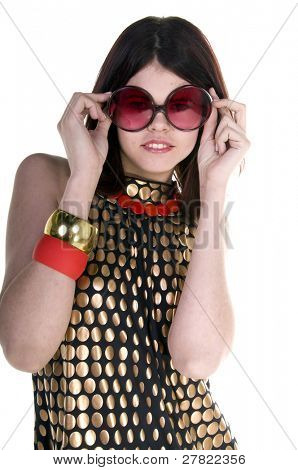 A beautiful and hip young woman in a black and gold Couture dress wearing big retro sunglasses