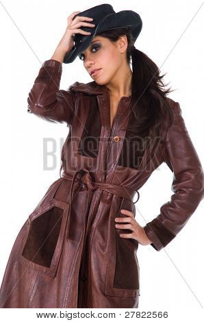 Beautiful young cowgirl in a leather duster