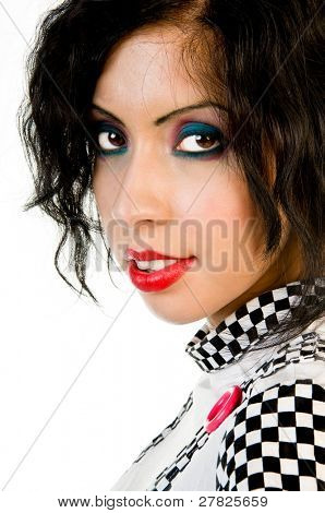 Beautiful young fashion model in a black and white checked dress with big candy color buttons