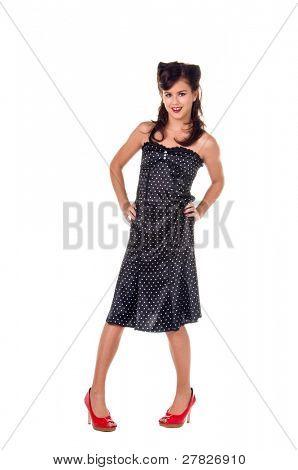 Beautiful teenage girl in 1950's rockabilly fashion polka dot dress, hair and red clutch purse