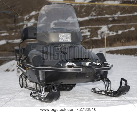 Black Snowmobile In Winter Mountains Close Up