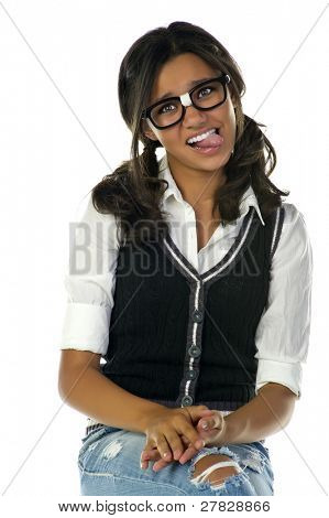 Teenage nerd girl with black glasses sticking out her tongue