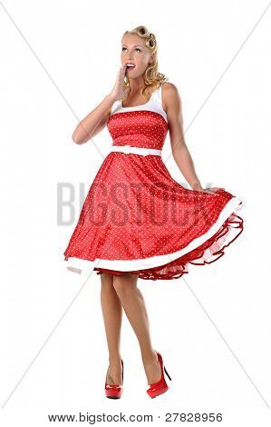 pretty blonde pinup model in a red and white polkadot dress