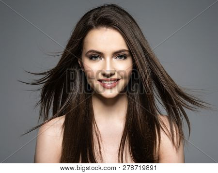 poster of Brunette smiling woman with beauty long brown hair. Fashion model with long straight hair. Fashion m