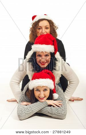 Happy Friends With Santa Hat Piled Up
