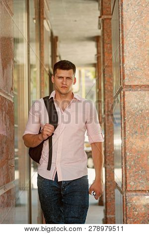 poster of Traveler Man With Travel Bag On Urban Outdoor, Wanderlust. Traveler With Backpack Travel On Vacation