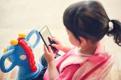 Children Playing Smartphone / Child Girl Hold Telephone In Hand Watching Cartoons At The School - As poster