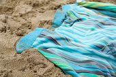 Colorful Summer Beachwear . Towel On Sand Beach. poster