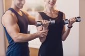 Happy Girl Doing Strength Exercise Dumbbell Hands. The Trainer Controls The Training The Woman Who P poster