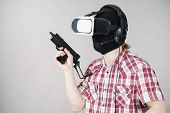 Man Playing Video Game Wearing Virtual Reality Device Holding Gun. Gaming Equipment For Gamers Conce poster