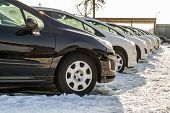 Parked Cars On A Lot. Row Of New Cars On The Car Dealer Parking Lot. Cars For Sale Market Theme. poster