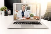 Doctor With A Stethoscope On The Computer Laptop Screen. Telemedicine Or Telehealth Concept. poster