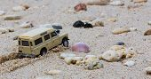 Toy 4x4 Offroad Vehicle Drives At The Beach poster