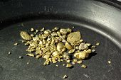 stock photo of gold mine  - Gold nuggets flakes and dust mined from the creeks and rivers of california