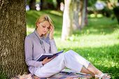 Best Self Help Books For Women. Girl Concentrated Sit Park Lean Tree Trunk Read Book. Reading Inspir poster