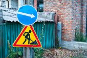 Road Signs, Traffic Sign On The Background Of A Green Fence And A Brick Wall, Traffic Sign To The Ri poster