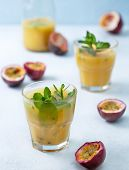 Tropical Juice With Passion Fruit, Mint In A Glass, Passion Fruit On A Blue Background poster