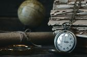 Travel Or Adventure Concept Background. Pocket Watch, Binoculars, Globe And Stack Of Books And Magni poster