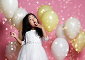 Surprised Asian Kid Girl With Balloons In Princess Dress With Tiara Princess Crown. Holds Balloon. G poster