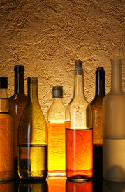 image of alcoholic drinks  - Lots bottles of alcohol drinks over textured background - JPG