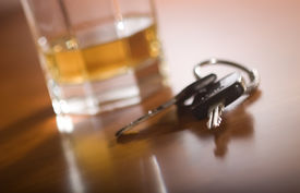 stock photo of designated driver  - A set of car keys in the foreground and glass of whiskey behind. ** Note: Slight blurriness, best at smaller sizes - JPG
