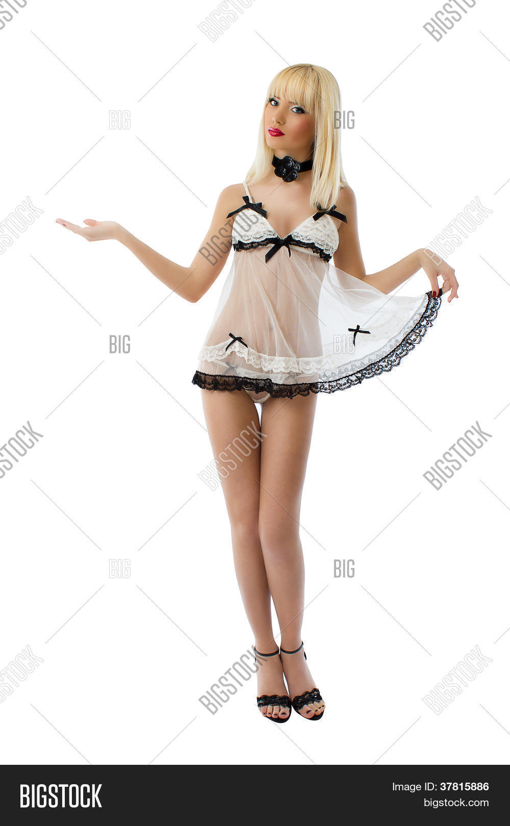 Full length of a sexy blonde model wearing white lingerie against white background