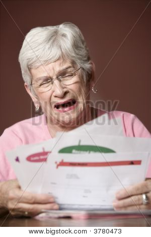 Senior Woman With Bills And Notices