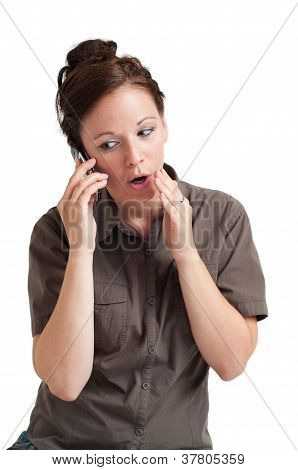 young woman telling secret by the cell phone