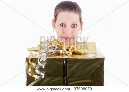 Attractive Woman Holds Golden Gift