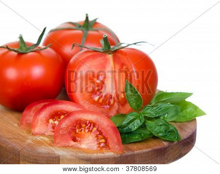 Tomatoes Horizontal Closeup  Presentation Sliced On Wooden Plank