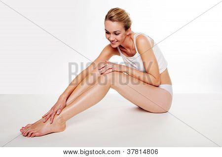 Beautiful Woman Caressing Her Legs