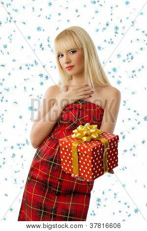 Beautiful Blonde Woman With Christmas Gift. Snowflakes