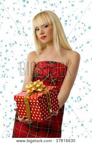 Blonde Woman With Christmas Gift. Snowflakes