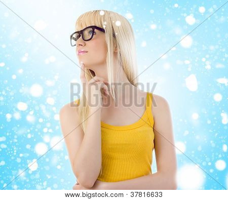 Woman In Glasses Daydreaming. Snowflakes
