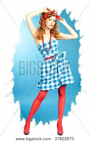 Pretty Redhead Pin Up Girl In A Checkered Dress And Red Stockings Adjusts The Bow On Her Head