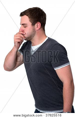 Sick man coughing into he's hand