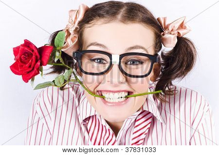 Cute Smiling Woman Wearing Nerd Glasses With Rose