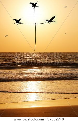 Beautiful & Heavenly Seaside In The Evening With Birds Carrying Thread Shaped As Holy Cross. The Eve