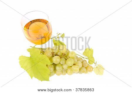 Green Grapes With Leaf And Wine In The Glass