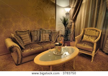 Interior With Stylish Furniture, Sparkling Wine And Glasses On The Table
