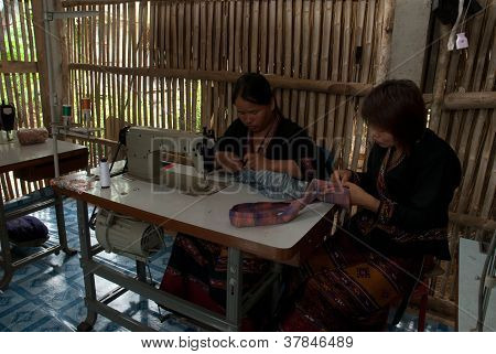 Hilltribe Sewing With A Sewing Machine .